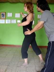 Early days of tango lessons, my first teacher Mauricio helps me find the position in his garage studio